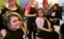 Trend Setters students styling hair while having a blast in beauty school