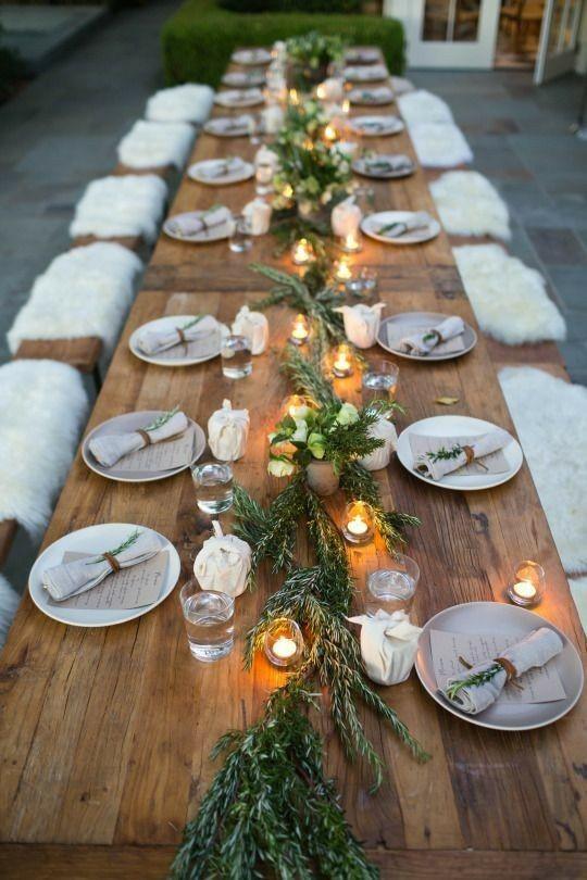 Decoración mesa de boda con ramas de olivo