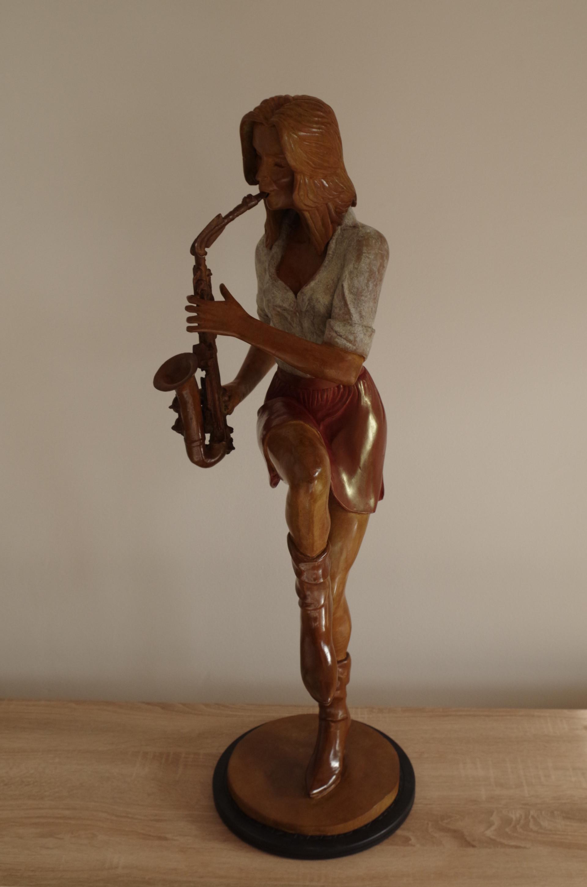 Elle jouait du saxo debout