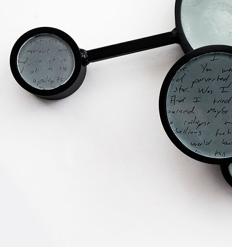 steel and glass sculpture text handwriting plaster cast