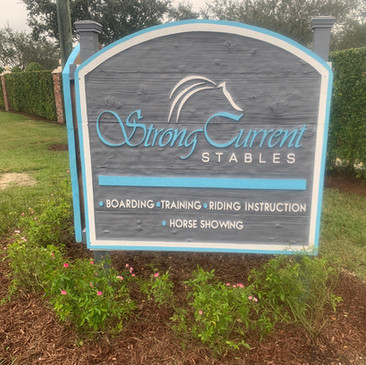 Strong Current Stables Sign.jpeg