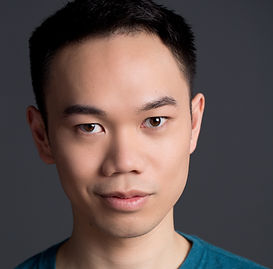 Image of Samson Syharath with a slight smirk. He is an Asian-American man.