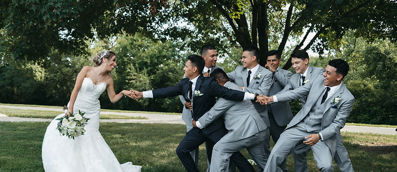 Fun bride and groom bridal party pictures with funny groomsmen