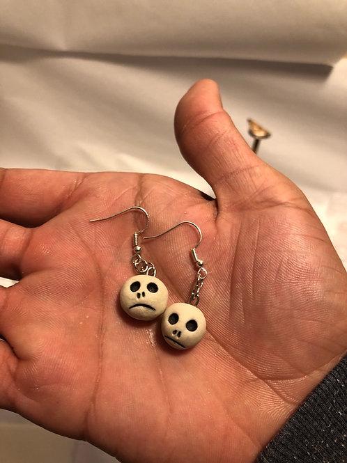 Tiny head/skull earring