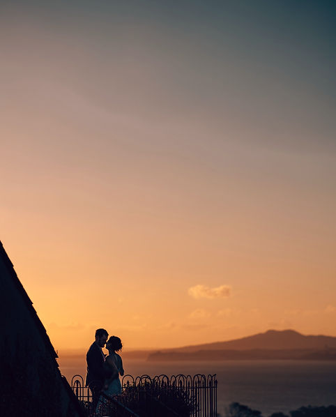 Auckland wedding photography of shilouette of bride and groom during sunset at Mudbrick