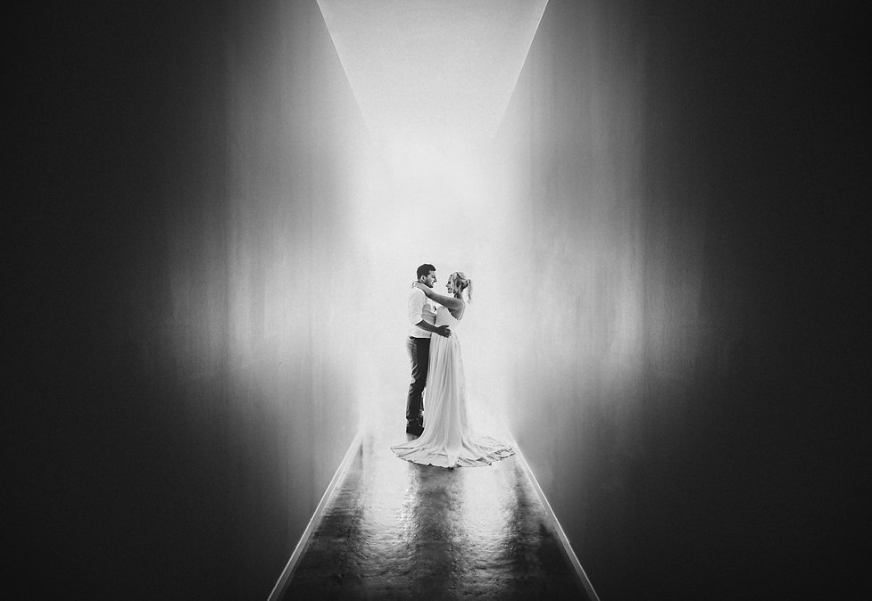 Bride and groom black and white wedding photography standing in at Brackenridge Country Estate in Martinborough