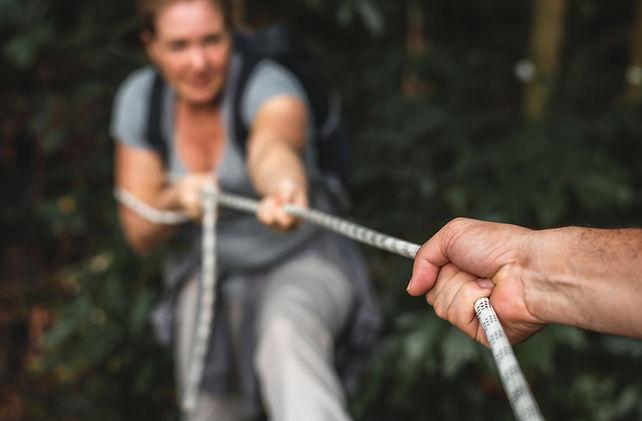 woman-climbing-up-a-rope-PLABFEV.jpg