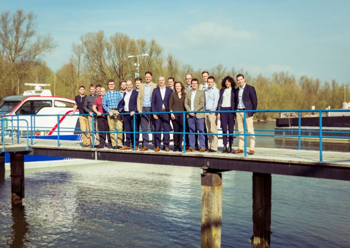 Members of Damen's Sea 1180 team gather on completion of the tender document