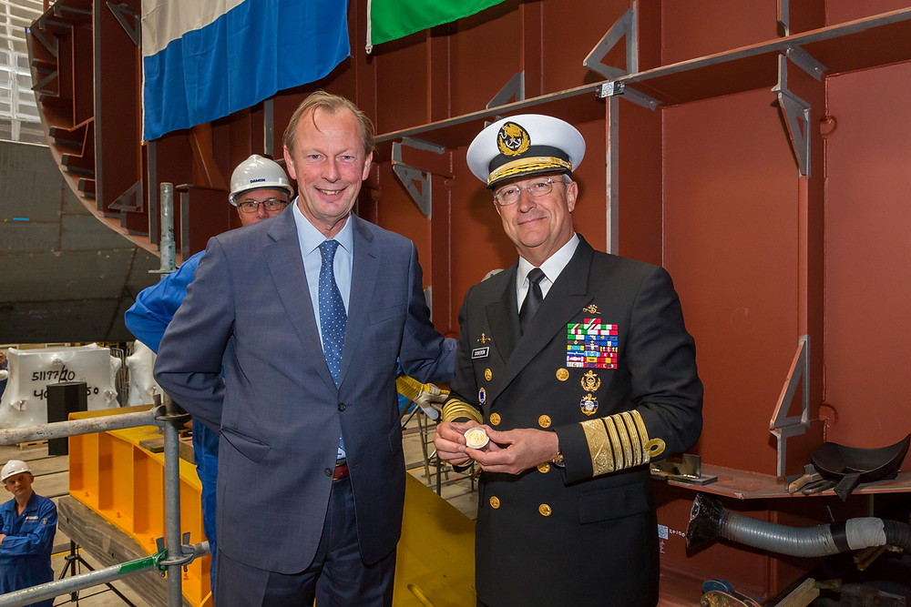 Admiral Vidal Francisco Soberón Sanz takes part in a symbolic coin ceremony at Damen Schelde Naval Shipbuilding