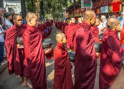 MONKS WAITING FOR ALMS,MYANMAR