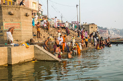 BATHERS IN THE GANGES RIVER