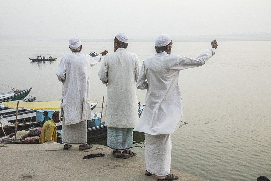 PRIESTS BLESSING THE GANGES RIVER