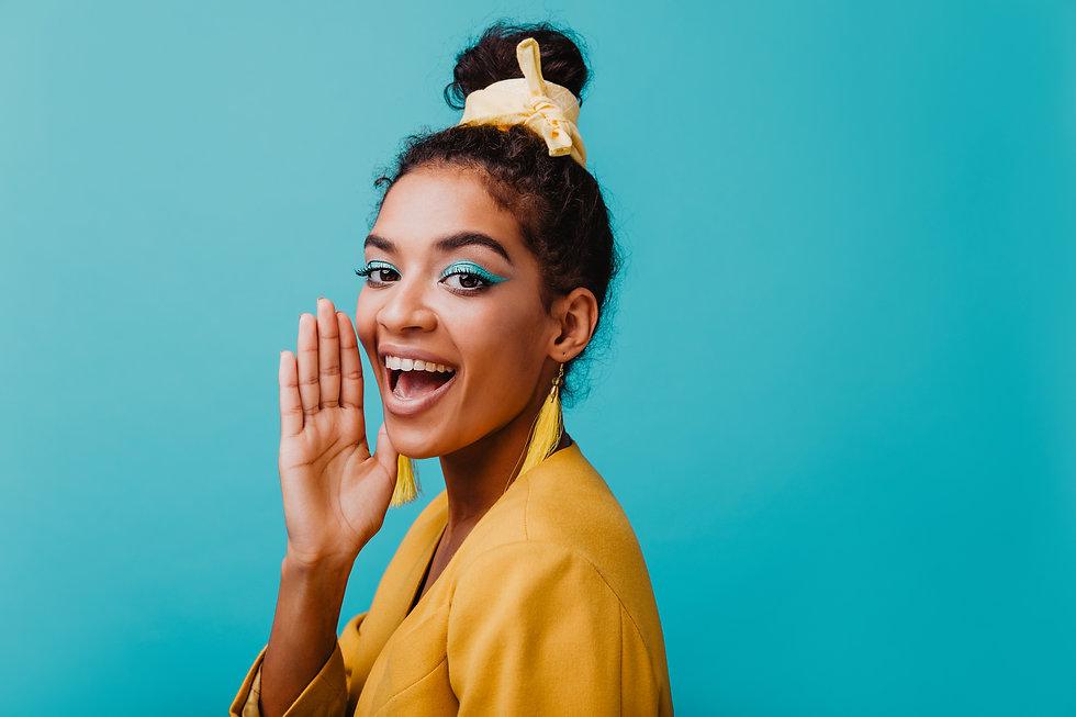 Refined black girl wears yellow earrings