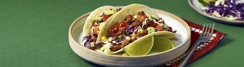 Plate of soft shell tacos made with MEET (brand) chicken style tenders using plant based protein food technology