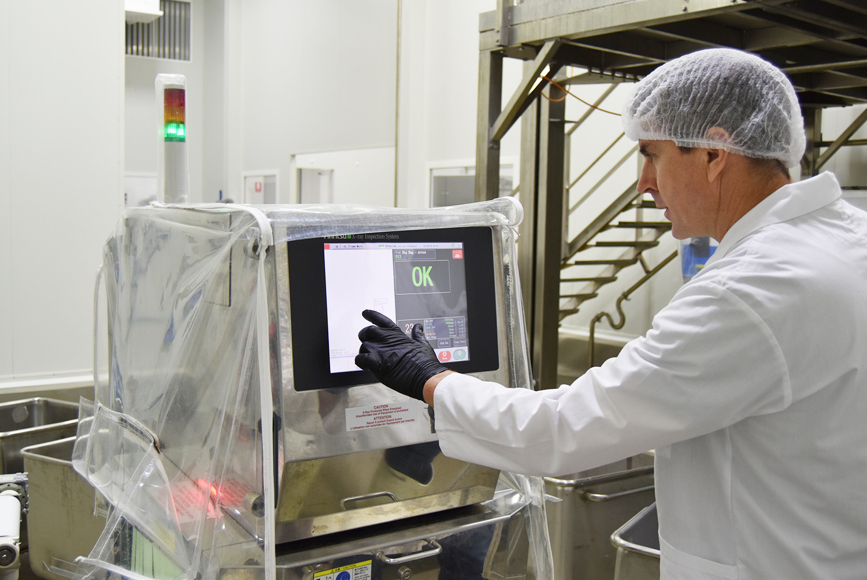 Proform Foods technician using monitor at Mount Kuring-gai, Food Manufacturing NSW facility