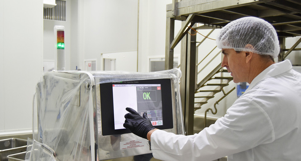Proform Foods technician using monitor at Mount Kuring-gai, Food Manufacturing NSW facility