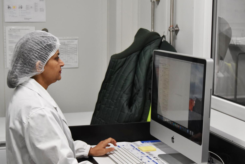 Proform Foods technician using computer at Mount Kuring-gai, Food Manufacturing NSW facility