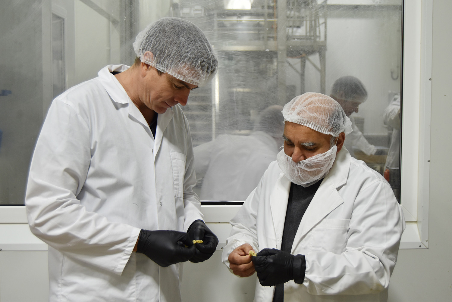 Proform Foods technicians assessing high moisture texturised protein at Mount Kuring-gai, Food Manufacturing NSW facility