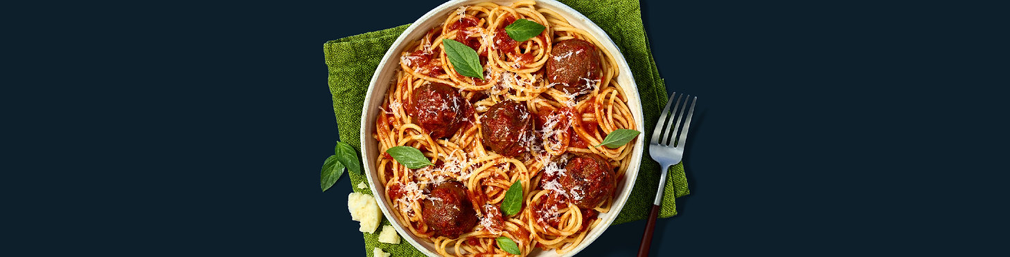 Bowl of spaghetti and MEET (brand) balls