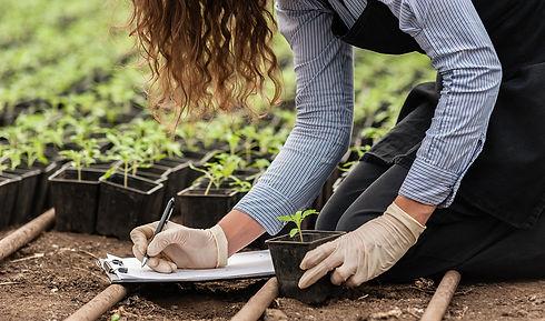 Proform Foods plant based food technology worker recording crop data