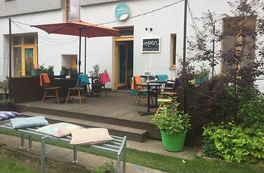 Garden entrance for Cookies and Cream Cafe located along the Historic Berlin Wall Path in Prenzlauer Berg