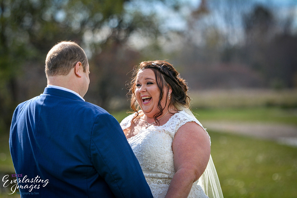 Bride and Groom share an intimate moment during their first look on their wedding day