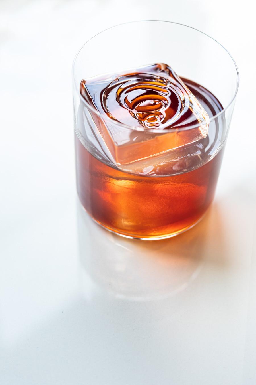 Negroni cocktail using Campari, Dolin rouge and Aquavit Aalborg