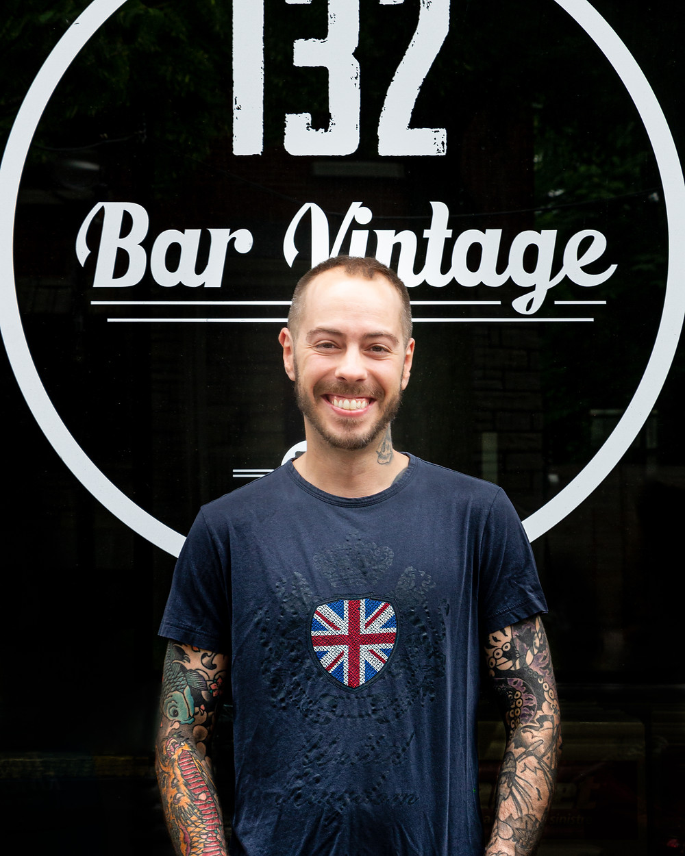 A portrait of Jean-Max Giguere, bar owner of 132 Bar Vintage in Montreal