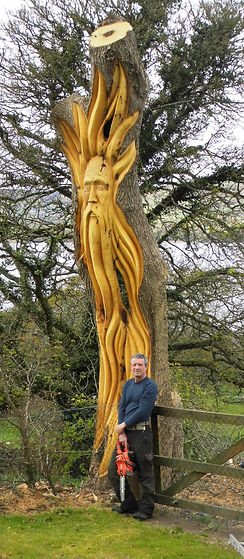 Fear na Coillt Chainsaw Sculptures Giant Wood Spirit carved in tree.  Will Fogarty