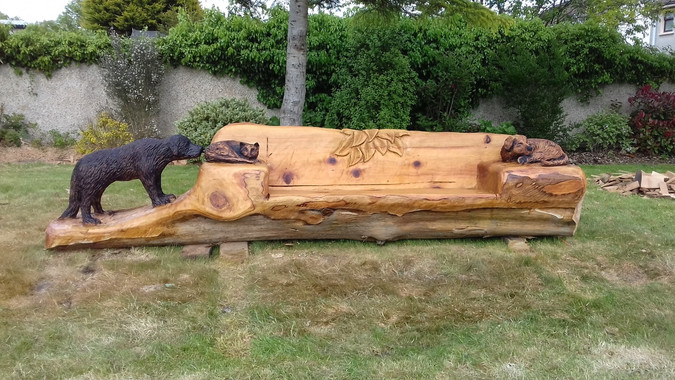 Fear na coillte chainsaw sculptures benches thrones seating