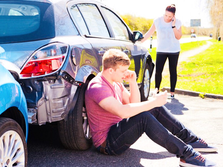 Who is responsible when a passenger is injured in a car crash?