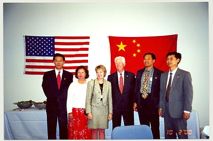 Peggy Wesp with Chinese officials 2000.j