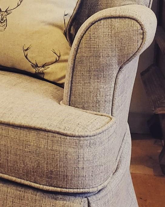 Swivel rocker in a grey textured fabric