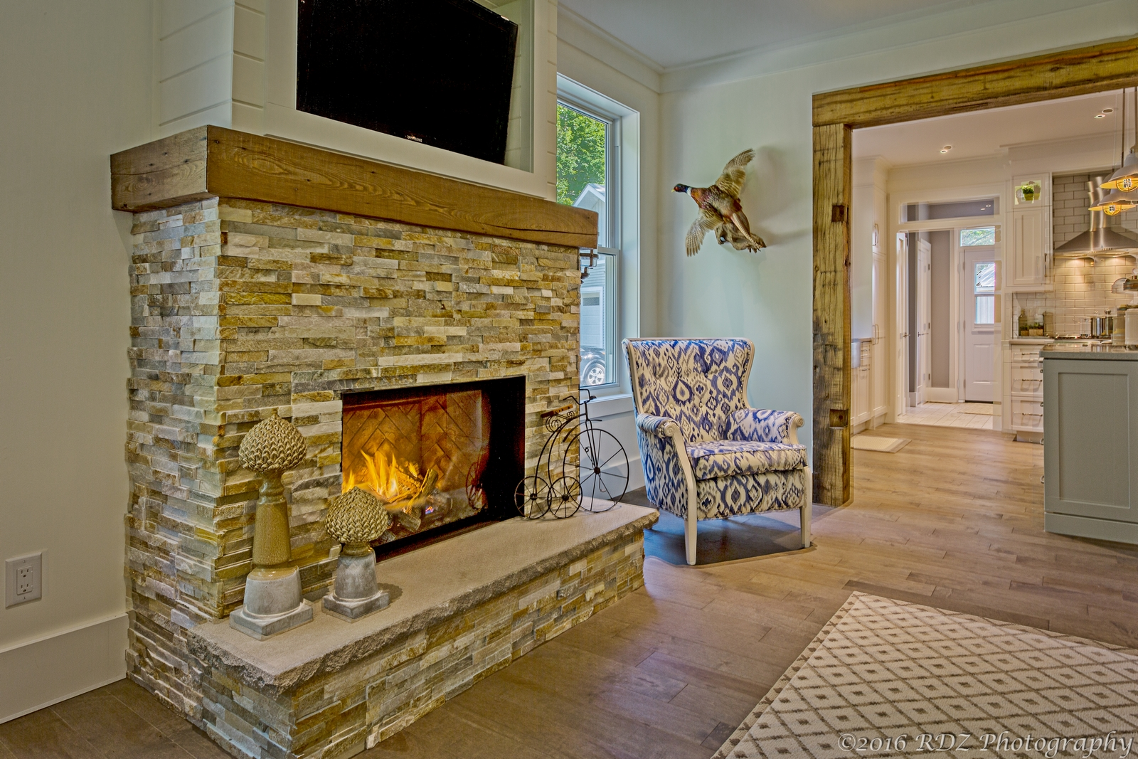 stone fireplace with beam mantle