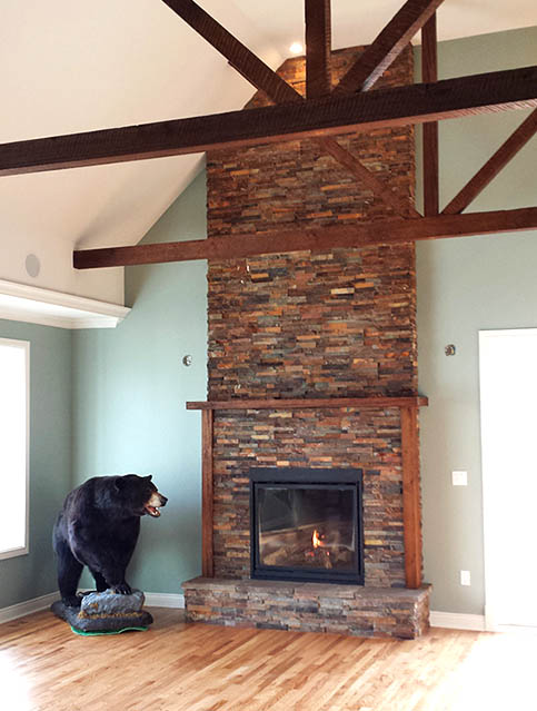 custom beams and stone fireplace