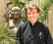 Sensei Frank outdoors with Hotai statue.