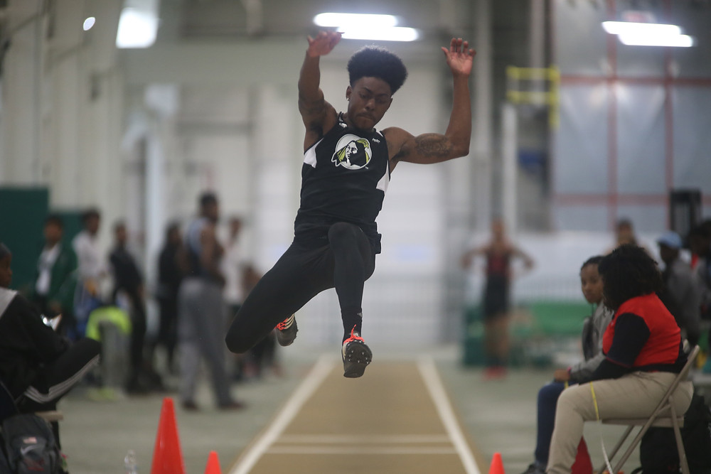 Kory Jones jumps in the long jump in a meet earlier this season.