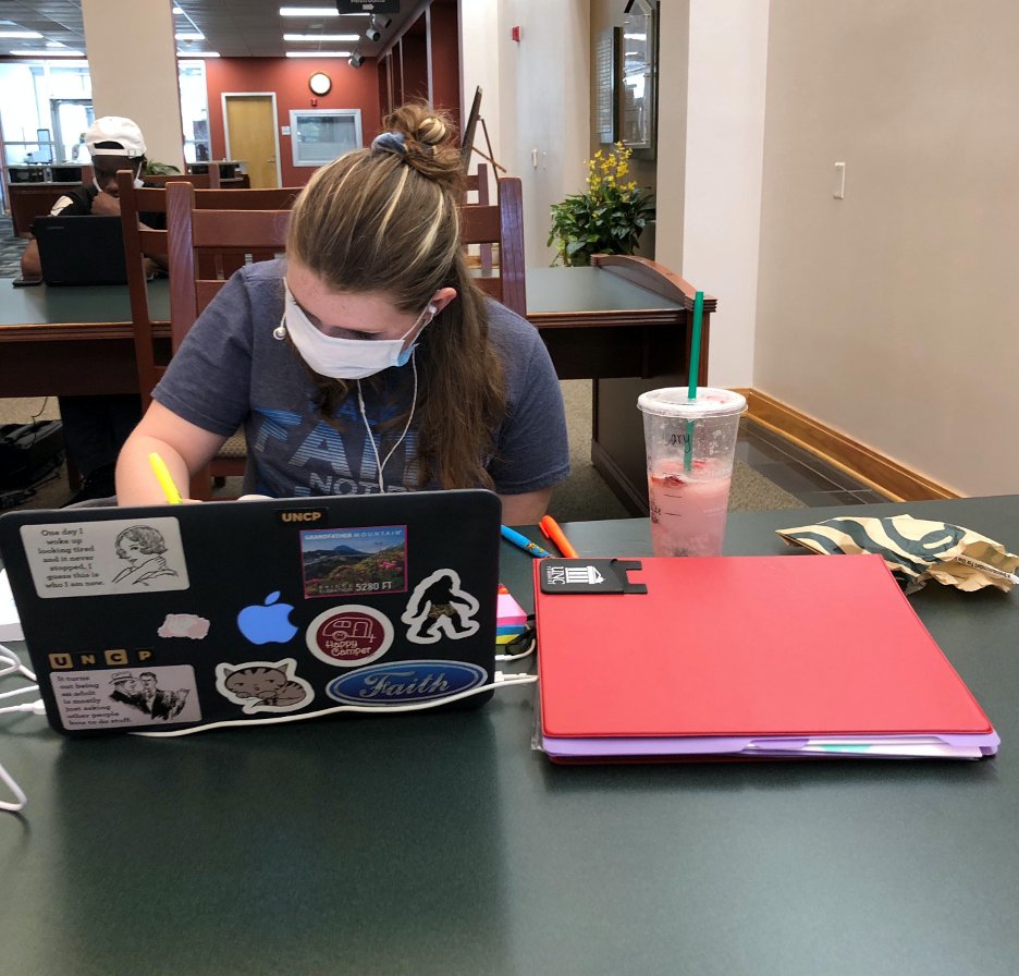Freshman Carrie Hawes-Sanders taking notes in the Mary Livermore Library.