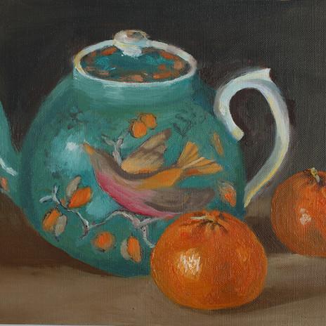 Chinese bird teapot and mandarins