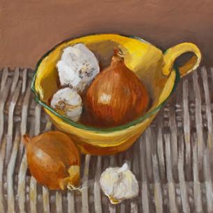 Onions in yellow bowl on rush mat.jpg