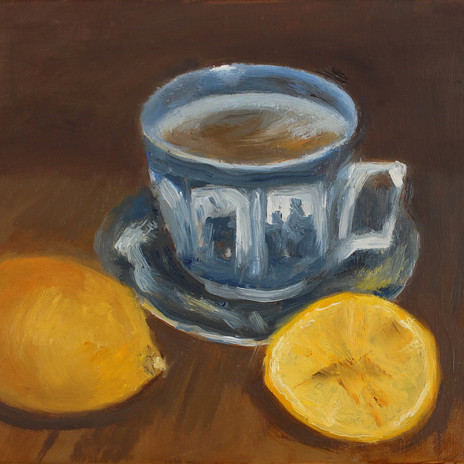 Chinese tea cup and lemons