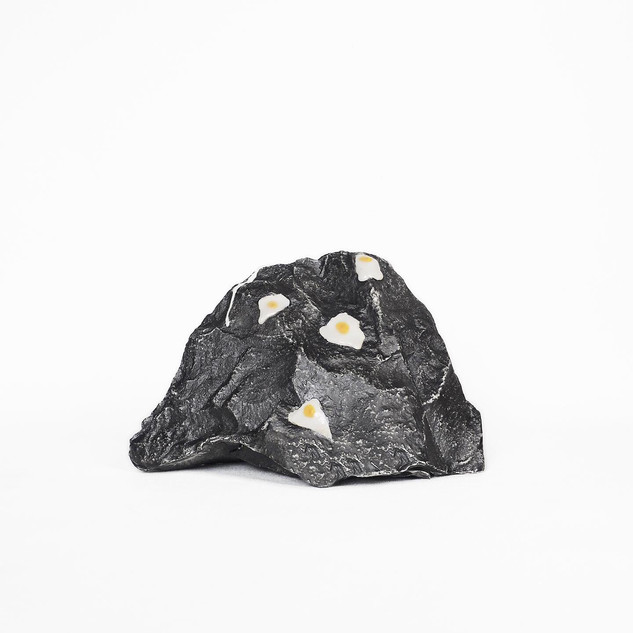 Striking the rock with an egg (2019) front