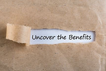 Uncover The Benefits text on brown envel