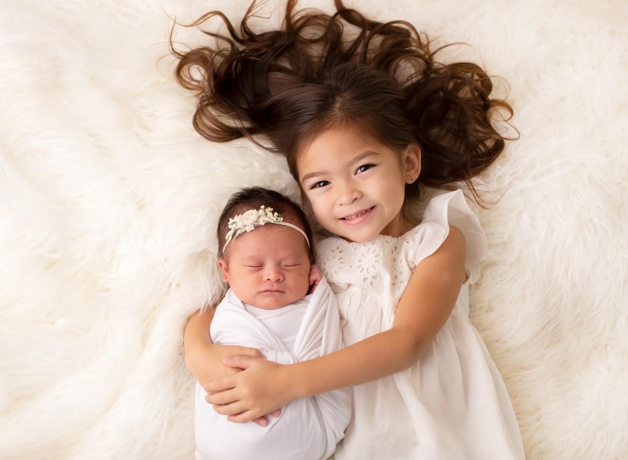 Newborn girl with big sister