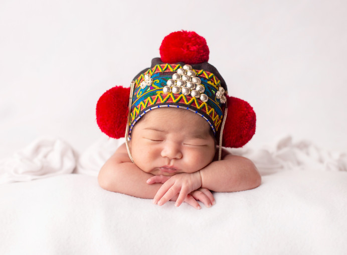 Newborn girl with traditional mien hat