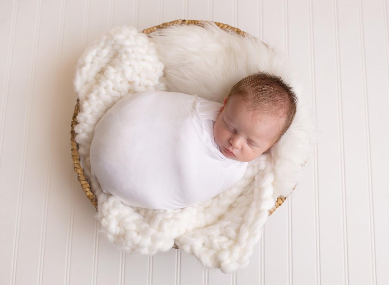 newborn boy all white