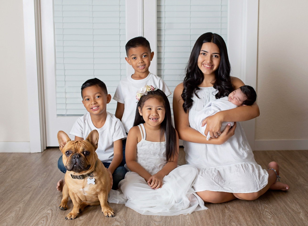 newborn boy and his siblings with their