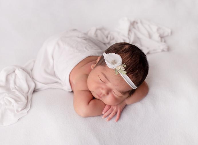 newborn girl in all white