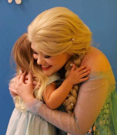 sofia hugging a child