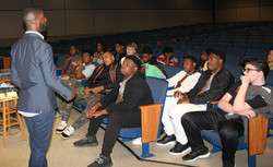Chris speaks with young men